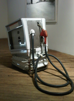 "Gas Pump, 2010, 1960s gas pump, linear actuator, height variable 22 "" wide 16 "" long."