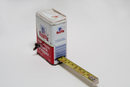 "'smells like my dad' tape, 2014, pepper can, tape measure guts and steel, 2.5"" x 3.5"" x 1"""